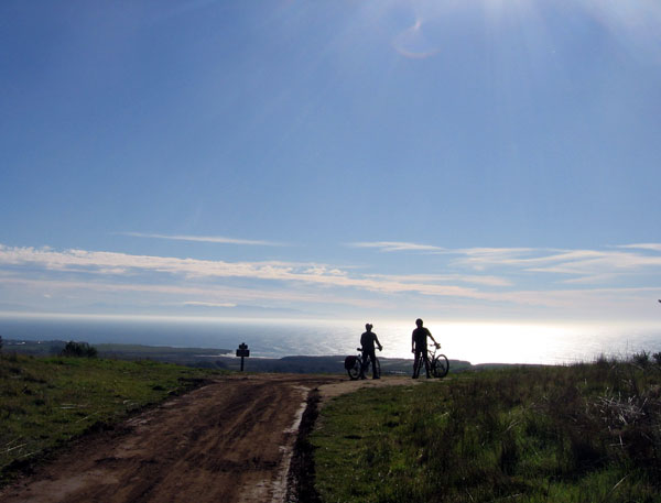 Mountain bikers look out over Santa Cruz's coast