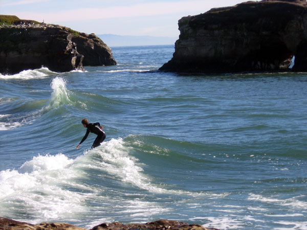 Surfers at Natural Bridges State Beach