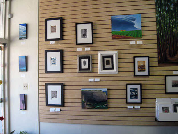 Paintings and prints next to the window