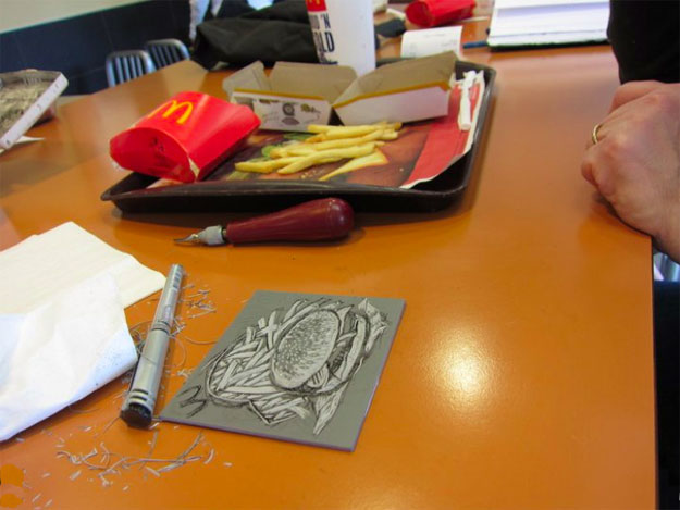 still life with lino block with knife and food