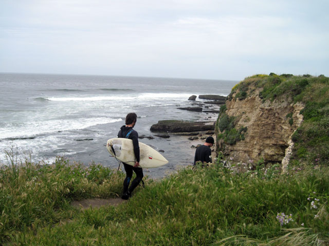 Surfers descending to the beach