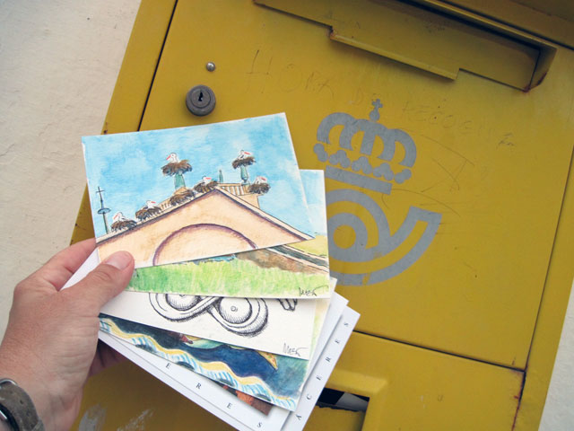 Mailing a batch of postcards in Carcaboso