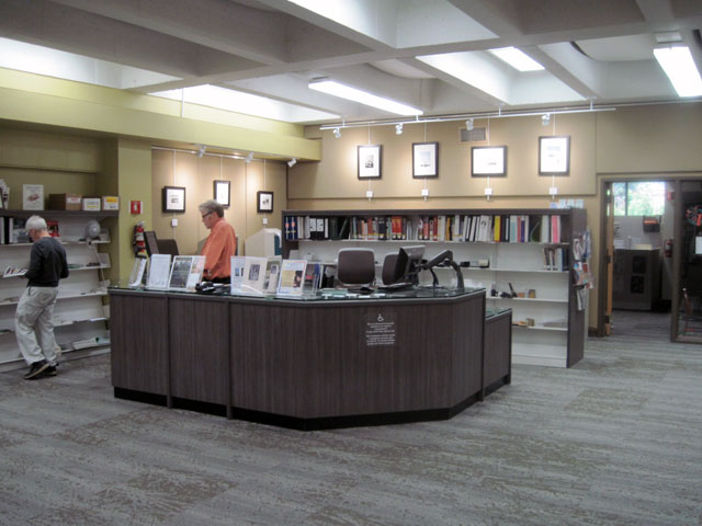 The reference desk is surrounded by prints