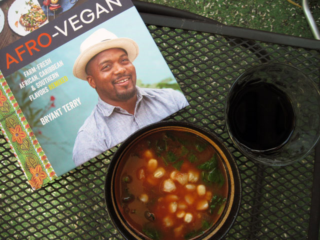 Afro-Vegan cookbook with Hominy and Spinach in Tomato-Garlic Broth