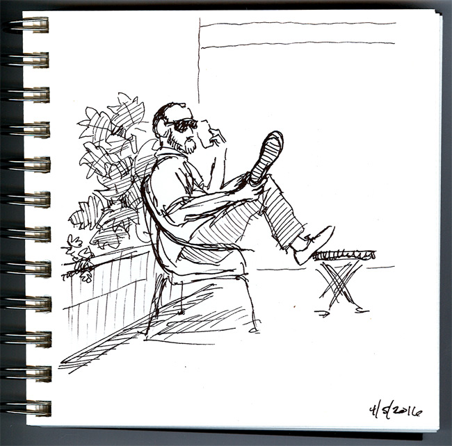 A quick sketch of a man on the phone at a cafe
